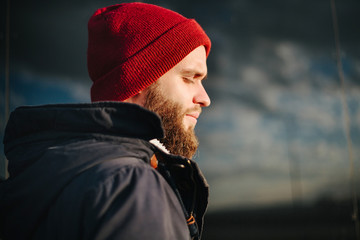 Man praying to God outside wearing winter clothes