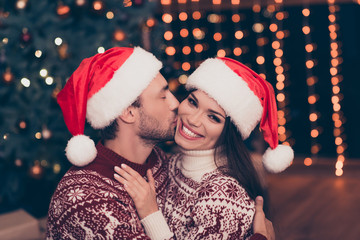 True love and feelings! Close up of adorable, lovely, sensual cute friends cuddling, brunette lady is with beaming smile, so cheerful, at home, pine firtree and sparkles around, winter, happiness
