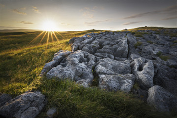Golden sunset over limestone landscape England