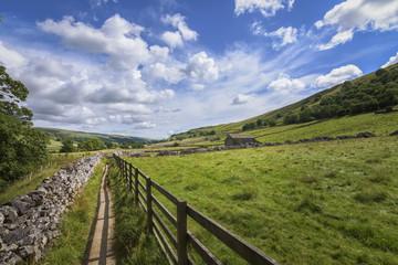 Walk through green countryside typical farmland England landscape