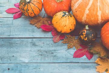 pumpkins and autumn leaves on wooden background. Autumn Pumpkin Thanksgiving concept