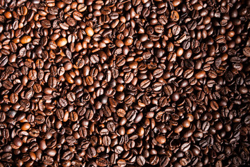 Coffee beans in close up photo. Refreshing moring drink