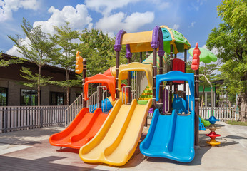 Colorful modern children playground in the park with blue sky background