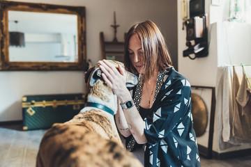 Woman cuddling greyhound