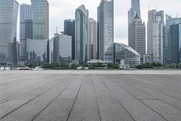cityscape and skyline of shanghai from empty brick floor.