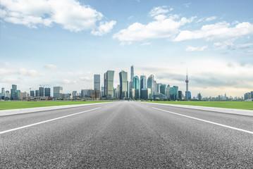Fotomurales - modern asphalt road through modern city skyline in shanghai