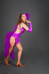 Nice Girl in Violet Costume Poses in Studio