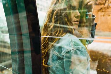 Sensual woman through glass
