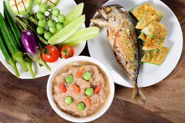 Thai food (Nam Prik Kapi),shrimp paste chili dip with fried mackerel omelette and fresh vegetables on wooden background