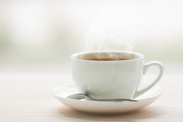 cup of hot steaming coffee