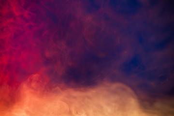 colorful smoke on dark blue background