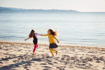 Sisters dancing on a sandy beach