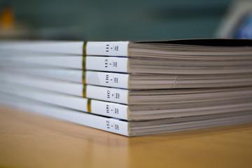 Several white magazine in stack
