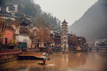 A man fishing on the river in ancient Phoenix Town, China