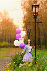 the girl celebrates her sixteenth birthday, a photo shoot with balloons