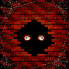 Evil eyes in the hole of the brick wall and spiders