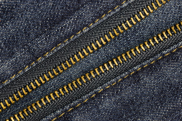 Close up metal zipper openning on blue jean.