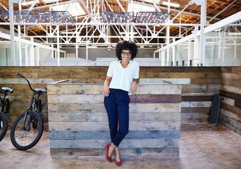 Portrait of millennial businesswoman at office