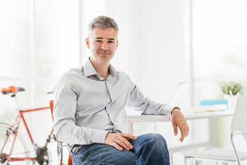 Confident businessman sitting in his office