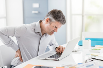 Businessman with backache