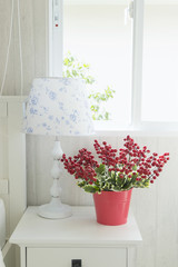 red flower and lamp in bedroom