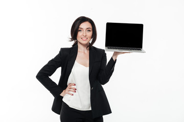 Portrait of a smiling brunette businesswoman in a suit