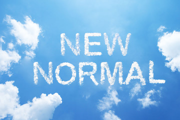 """""""NEW NORMAL"""" cloud word on sky."""