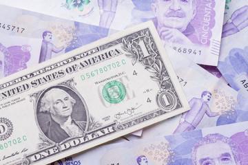 A Dollar Bill On Bills Of 50 Thousand Colombian Pesos
