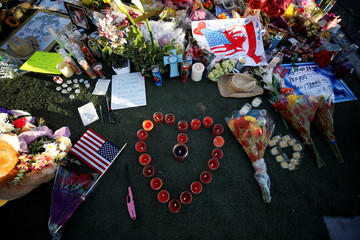 A makeshift memorial is pictured in the middle of Las Vegas Boulevard following the mass shooting in Las Vegas
