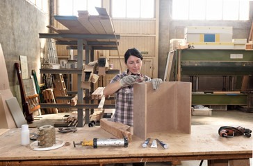 a woman working in a carpentry workshop