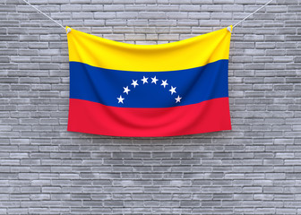 Venezuela flag hanging on brick wall. 3D illustration