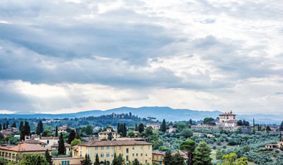 Beautiful Tuscan country, rural scene, clouds, houses and greenery