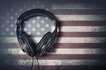 Headphones on grunge American flag background