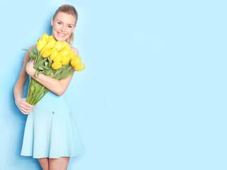 Beautiful blonde got a yellow tulips.