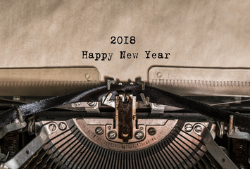Happy New Year 2018 words typed on a Vintage Typewriter. Mechanisms closeup. Typing on old typewriter. Greeting card with a holiday