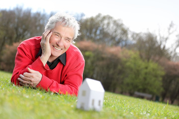 Series of a happy Senior Pensioner, imagining his new future home with a Little Paper house