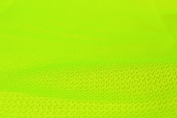 Green textile with a fold on focus