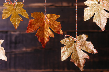 Glitter covered fall maple leaves