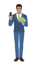 Businessman holding mobile phone and money