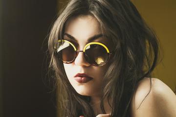 Beautiful girl wearing funky sunglasses