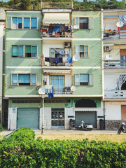 Italy - Green Apartment Block With Laundry Hanging on Balcony