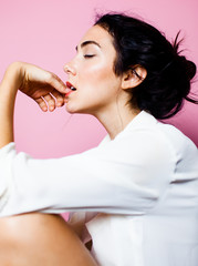 Side profile of woman biting her nails
