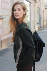 Portrait of young woman standing on the street