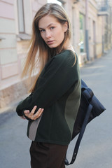 Young woman with a backpack looking at camera