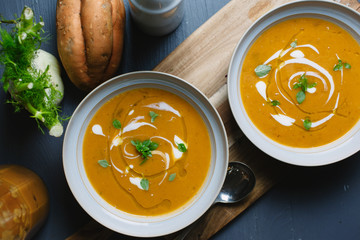 Two bowls of roasted sweet potato and fennel soup.