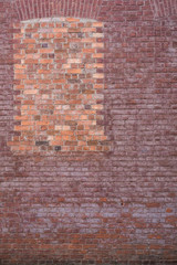 Brick wallk and bricked in window