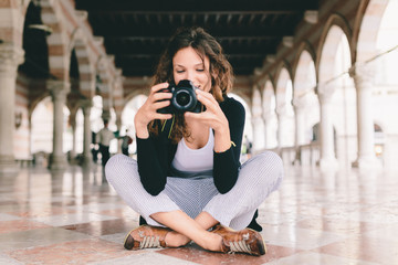 Pretty Young Female Photographer Taking Pictures in Italy