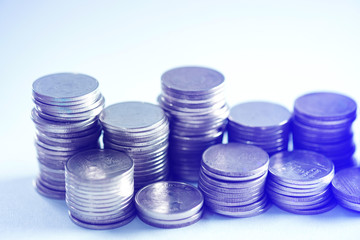 Piles of coins on working table, finance and business concept, shallow focus.