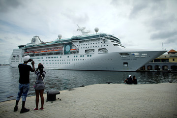People take pictures of the cruise ship MS Empress of the Seas which is operated by Royal Caribbean International in Havana, Cuba