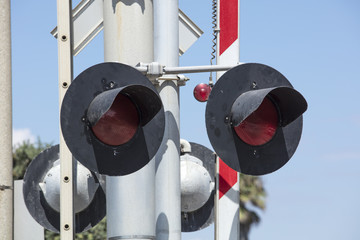 Close up of a railroad crossing light and barrier